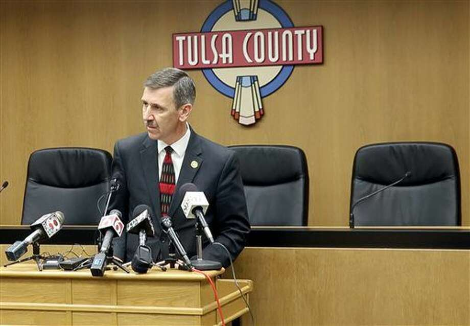 Tulsa District Attorney Steve Kunzweiler addresses the media during a news conference at the Tulsa County Courthouse on Thursday, Sept. 22, 2016 in Tulsa, Okla. Kunzweiler announced that his office has filed first degree manslaughter charges against Tulsa Police Officer Betty Shelby after the shooting death of Terence Crutcher last Friday night. (Ian Maule/Tulsa World via AP)