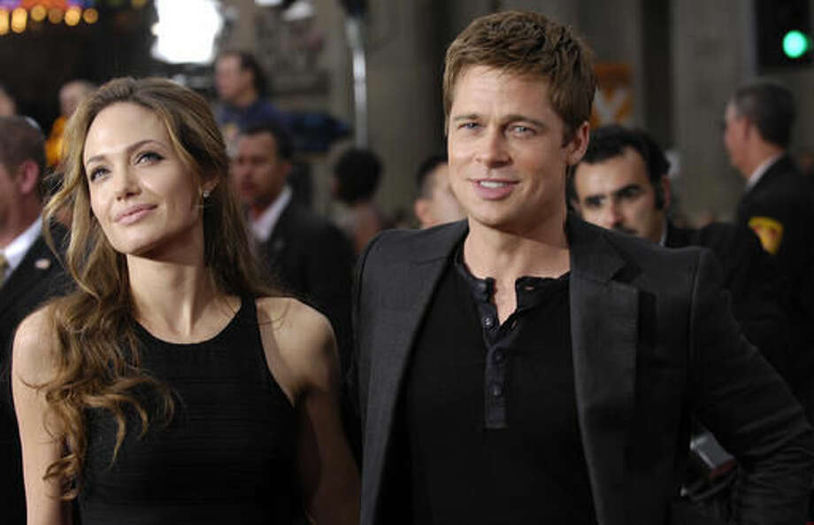 """FILE - In this June 5, 2007 file photo, Brad Pitt, right, a cast member in the film """"Ocean's Thirteen,"""" arrives with Angelina Jolie at the premiere of the film at Grauman's Chinese Theatre in Los Angeles. Angelina Jolie Pitt has filed for divorce from Brad Pitt, bringing an end to one of the world's most star-studded, tabloid-generating romances. An attorney for Jolie Pitt, Robert Offer, said Tuesday, Sept. 20, 2016, that she has filed for the dissolution of the marriage. (AP Photo/Chris Pizzello, File)"""