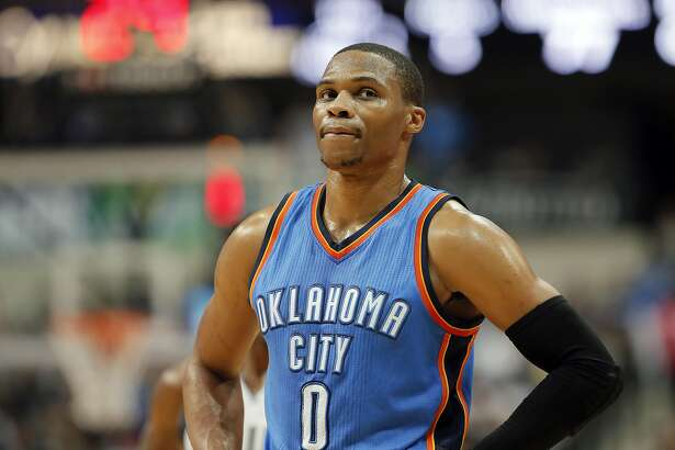 Oklahoma City Thunder guard Russell Westbrook (0) stands on the court watching as the Dallas Mavericks attempt free throws during a preseason NBA basketball game, Tuesday, Oct. 11, 2016, in Dallas. (AP Photo/Tony Gutierrez)