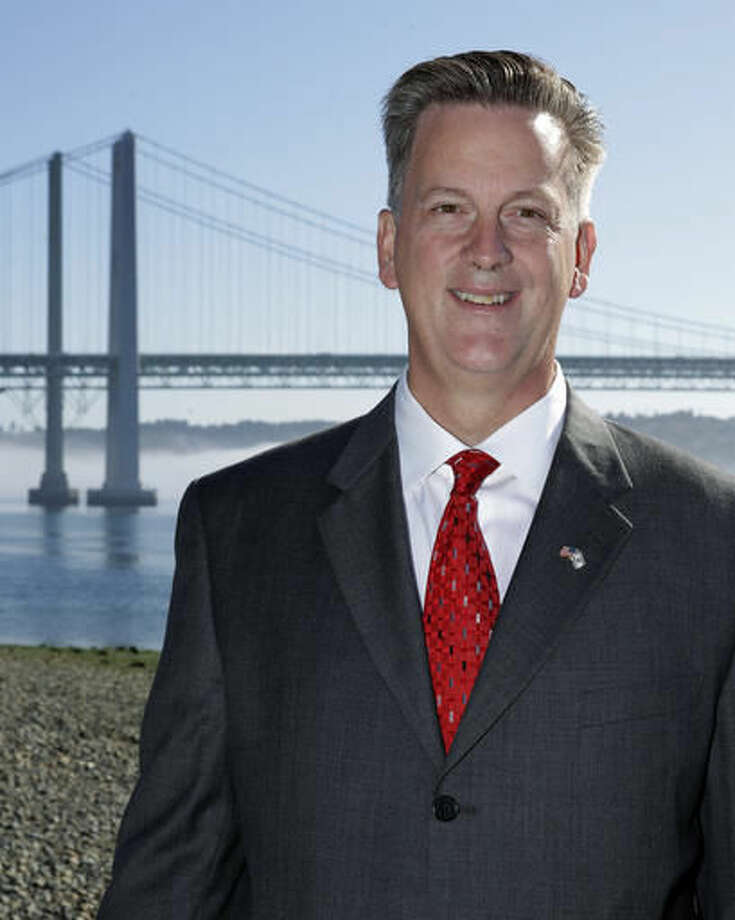 In this photo taken Aug. 29, 2016, Marty McClendon, the Republican candidate for Washington state lieutenant governor, poses for a photo near the Tacoma Narrows Bridge in Gig Harbor, Wash. McClendon, a real estate agent, pastor and conservative talk show host, is facing Democratic state Sen. Cyrus Habib of Bellevue, Wash. (AP Photo/Ted S. Warren)