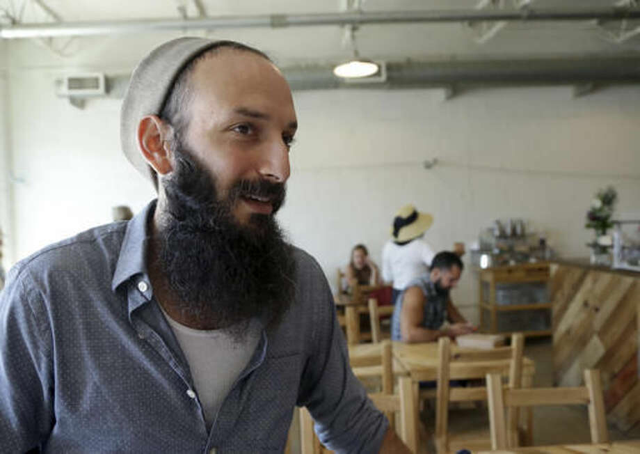 Zak Stern, the owner of Zak the Baker, a small business in the Wynwood neighborhood of Miami, talks with the news media, Monday, Sept. 19, 2016. Florida Gov. Rick Scott announced Monday that the arts district is no longer considered a zone of active Zika transmission. It has been 45 days since the last Zika detection. (AP Photo/Lynne Sladky)