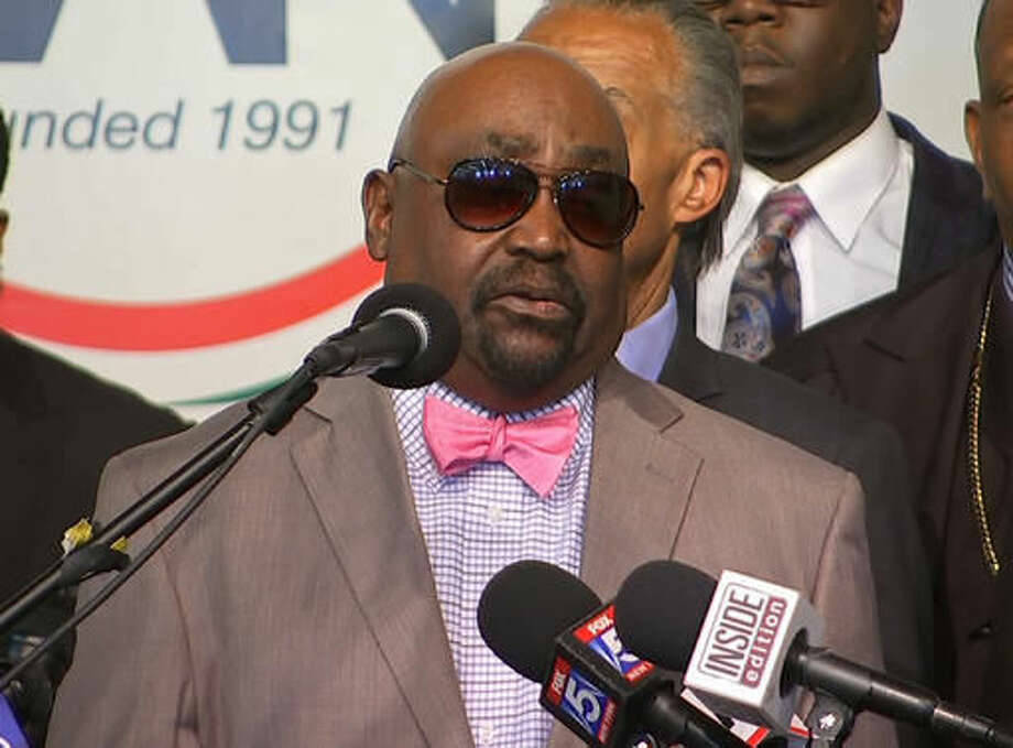 In this image taken from video, The Rev. Joey Crutcher, father of Terence Crutcher, speaks to the media at the National Action Center in New York, Wednesday, Sept. 21, 2016. Crutcher's son, 40 year old Terence Crutcher, was shot and killed by a white Tulsa, Oklahoma police officer on Friday, Sept. 16, 2016. (AP Photo/Joseph Frederick)