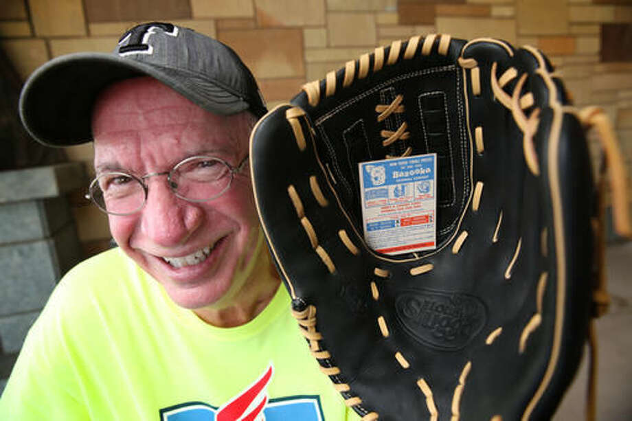 Darwin Day poses for a photograph with the baseball glove he recently won from a 1957 Bazooka Gum contest at The Summit in Grand Prairie, Texas on Sept. 7, 2016. Day was cleaning his house and found some Topps baseball cards from 1957-58. The cards were included with Bazooka bubble gum purchases. Day said no deadline was given, so he sent the entry card to an executive with Bazooka Candy Brands and received a new baseball glove. (Rose Baca/The Dallas Morning News via AP)