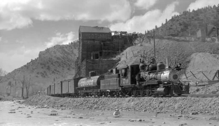 In this 1941 photo provided by the Denver Public Library Western History Collection, a Colorado & Southern narrow-gauge freight train stands outside the Argo Mill and Tunnel complex in Idaho Springs, Colo. The mill and tunnel complex are part of an extensive Superfund cleanup. (Otto Perry/Denver Public Library via AP)