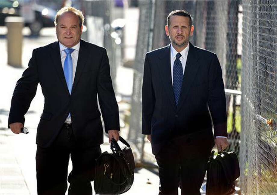 David Wildstein,right, former Port Authority appointee of New Jersey Gov. Chris Christie, arrives at the Martin Luther King Jr. Federal Courthouse with his attorney Alan Zegas, left, on Monday, Sept. 26, 2016.. Wildstein will continue to testify in the Bridgegate trial. (Amy Newman/The Record of Bergen County via AP)