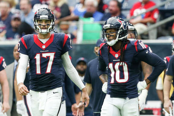 Houston Texans quarterback Brock Osweiler (17) and wide receiver DeAndre Hopkins (10) walk onto the field during the second quarter of an NFL football game against the Tennessee Titans at NRG Stadium on Sunday, Oct. 2, 2016, in Houston. ( Brett Coomer / Houston Chronicle )