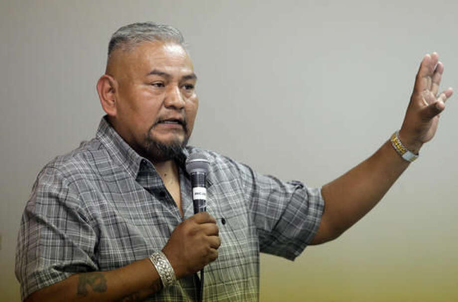 """In this Aug. 22, 2016, photo, Navajo Nation member Davis Filfred speaks during a meeting with the Navajo Tribal Utility Authority at the Red Mesa Chapter, near Montezuma Creek, Utah. Filfred is among the tribal members hoping a federal judge on Wednesday, Sept. 22 grants the group's request for an injunction that would require the county to restore polling places for the November election and staff them with bilingual workers who can help Navajo speakers. """"A lot of Navajos don't understand the mail-in ballot,"""" said Filfred. """"They would rather go to a polling place. That's what they're accustomed to and they want that back. (AP Photo/Rick Bowmer)"""