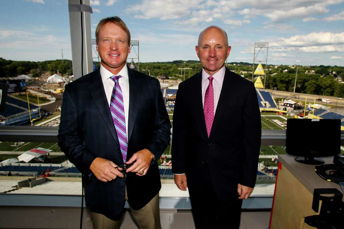 ESPN Monday Night Football announcers Jon Gruden, left, and Sean McDonough stand in the press box of Tom Benson Hall of Fame Stadium before a preseason NFL football game between the Green Bay Packers and the Indianapolis Colts,Sunday, Aug. 7, 2016, in Canton, Ohio. (AP Photo/Gene Puskar)
