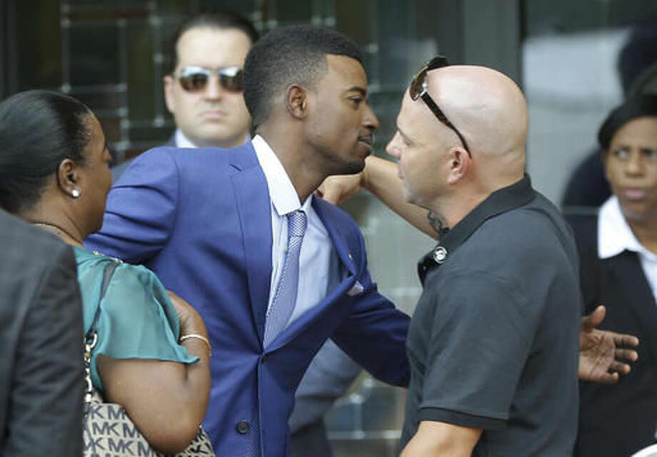Miami Marlins second baseman Dee Gordon, center, arrives for a memorial service for Miami Marlins pitcher Jose Fernandez, at St. Brendan's Catholic Church, Thursday, Sept. 29, 2016, in Miami. Fernandez was killed in a boating accident Sunday along with two friends. (AP Photo/Lynne Sladky)