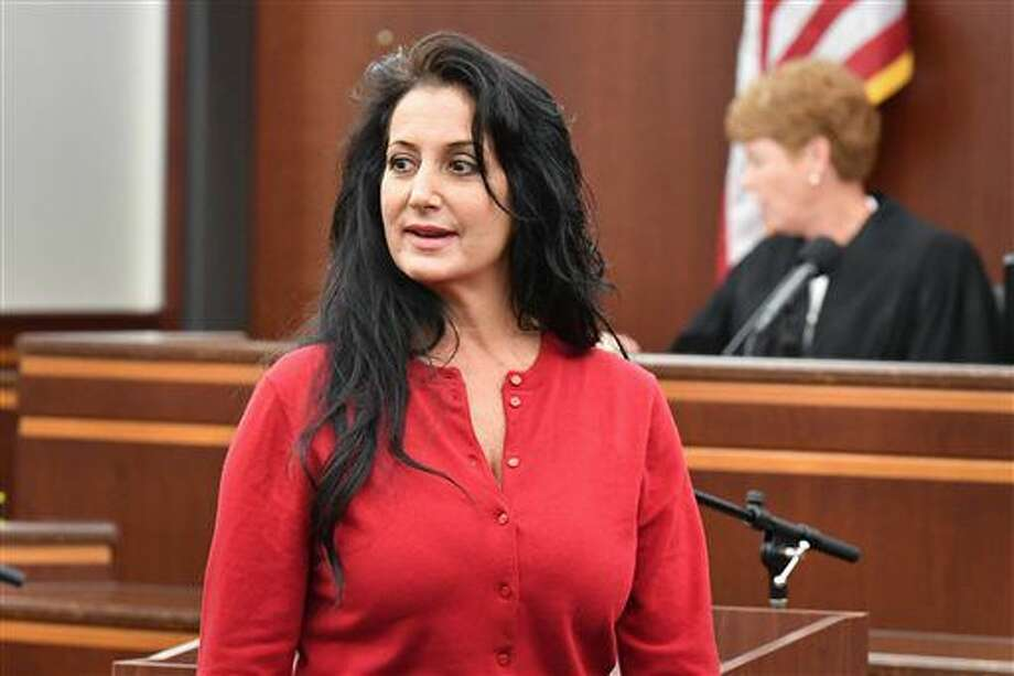 Sandra Grazzini-Rucki appears in court during her sentencing, Wednesday, Sept. 21, 2016, in Hastings, Minn. Grazzini-Rucki was convicted in July of felony deprivation of parental rights for hiding her daughters for more than two years from their father. (Glen Stubbe/Star Tribune via AP, Pool)
