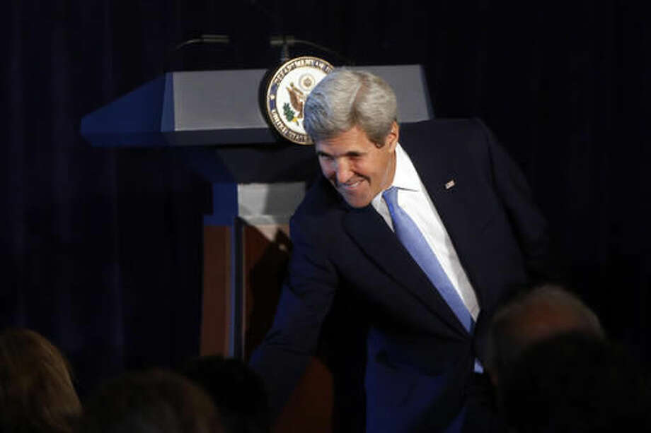U.S. Secretary of State John Kerry greets an attendee as he arrives at a Montreal Protocol donor declaration event, Thursday, Sept. 22, 2016, in New York. (AP Photo/Jason DeCrow)