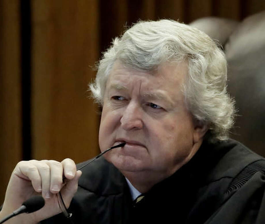 Justice Dan Biles questions council during arguments in a school funding case at the Kansas Supreme Court Wednesday, Sept. 21, 2016, in Topeka, Kan. The hearing stems from a 2010 lawsuit brought by four school districts contending schools are underfunded by the state. (AP Photo/Charlie Riedel)