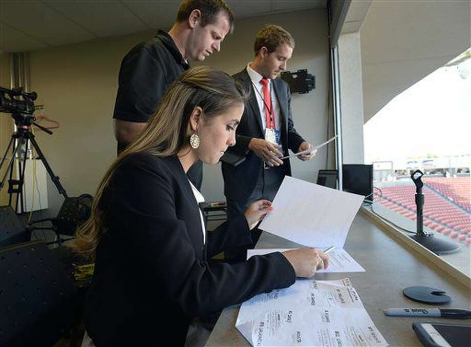 Announcers Carla Swensen Haslam and Landon Southwick, right, go over the broadcast plan with producer Nate Moffett, Friday, Sept. 9, 2016 at Rio Tinto Stadium in Sandy, Utah. Haslam, a junior forward on the nationally-ranked BYU women's soccer team, also serves as the color commentator on the broadcast for Real Monarchs matches. (Scott Sommerdorf/The Salt Lake Tribune via AP)