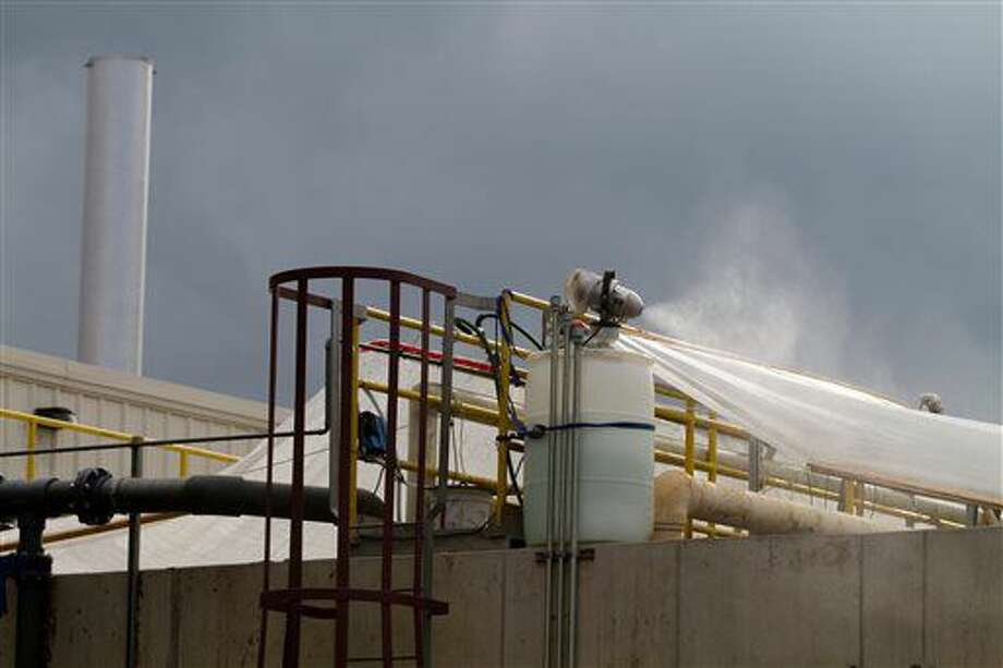 An exterior view of the Wastewater pre-treatment fragrance misters, as seen during a tour inside the Lowell Energy AD Biodigester on Sept. 8, 2016, in Lowell, Mich. The operator of a biodigester in western Michigan has until Nov. 1 to curb odors in the area or it could be shut down. (Tom Brenner/The Grand Rapids Press via AP)