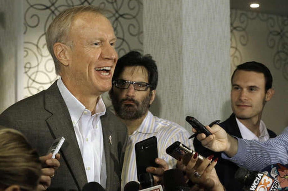 Illinois Gov. Bruce Rauner speaks to reporters Monday, Sept. 19, 2016, in Springfield, Ill. Rauner eliminated a state Transportation Department position that he says was central to a patronage hiring scandal stretching back more than a decade. (AP Photo/Seth Perlman)