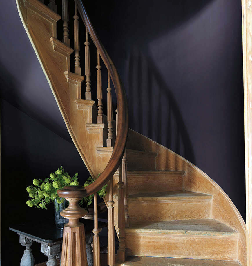 "The walls along this staircase are painted in Benjamin Moore's ""Shadow,"" a very dark purple that is the company's 2017 Color of the Year. / Bessler_2014"