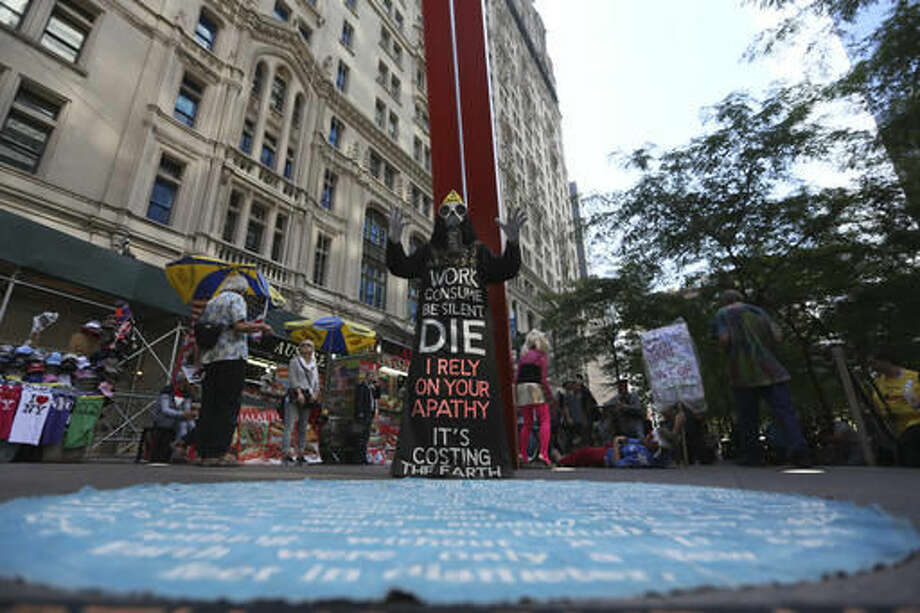 An Occupy Wall Street activist takes part in the fifth anniversary of the movement in Zuccotti Park in New York on Saturday, Sept. 17, 2016. (AP Photo/Mary Altaffer)