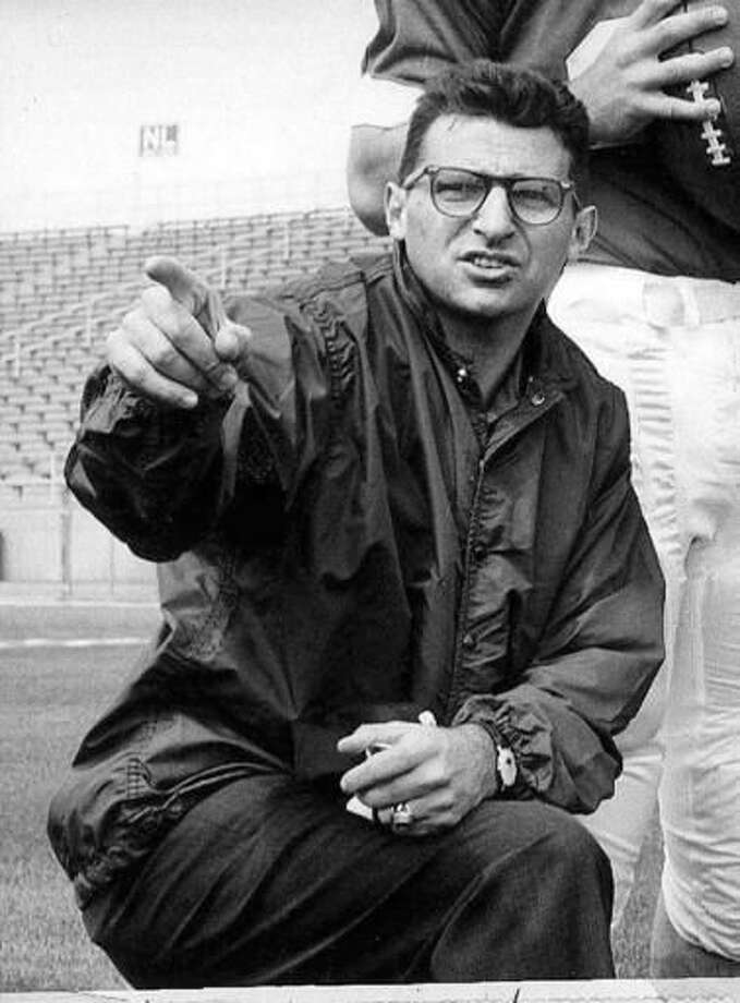 FILE - In this Jan. 28, 1965, file photo, Joe Paterno, associate football coach at Penn state, directs players at State College, Pa. As Penn State's athletic department finalizes details for how to honor the 50th anniversary of Joe Paterno's first win, hundreds of the late coach's former players were on their way to town to attend a private reunion planned for Friday at the school's baseball stadium. (AP Photo, File)