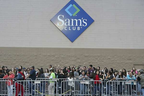 Austin Mahone fans wait in line for photos with Mahone Thursday Dec. 11, 2014 at Sam's Club.