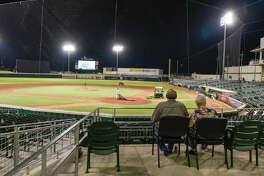 The grounds crew worked for 2 1/2 hours on the Uni-Trade Stadium field Thursday before the Lemurs' game against Texas was canceled. Rain fell earlier in the afternoon causing the surface to be unplayable. Fans watched the preseason football game between the Cowboys and Texans on the scoreboard during the wait.