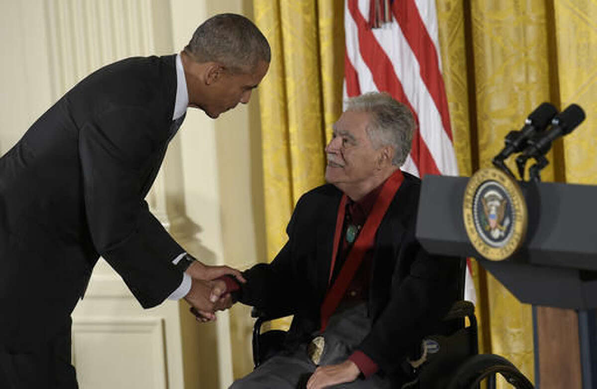 President Barack Obama shakes hands with author, Rudolfo Anaya after presenting him with the 2015 National Humanities Medal during a ceremony in the East Room of the White House in Washington, Thursday, Sept. 22, 2016. (AP Photo/Susan Walsh)