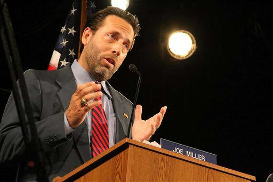 FILE - In this Aug. 10, 2014, file photo, then-Republican U.S. Senate candidate Joe Miller speaks during a debate in Anchorage, Alaska. Miller announced Tuesday, Sept. 6, 2016, that he is running for U.S. Senate as a Libertarian after losing U.S. Senate races in Alaska in 2010 and 2014 as a Republican. (AP Photo/Mark Thiessen, File)
