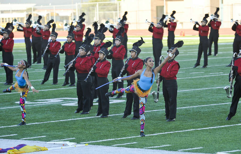 In this Oct. 4, 2014 file photo, the Martin High School Color Guard performs with the Martin High School marching band during the UISD Marching Band Festival at the Student Activity Complex.