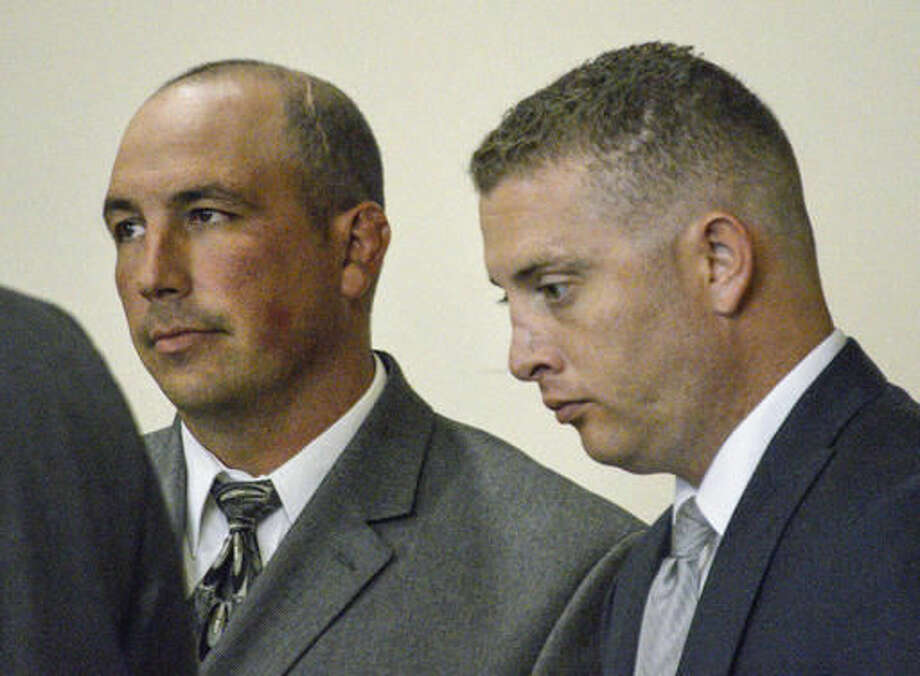 FILE - In this Aug. 18, 2015 file photo, former Albuquerque Police detective Keith Sandy, left, and Officer Dominique Perez speak with attorneys during a preliminary hearing in Albuquerque, N.M. The two Albuquerque police officers who opened fire on a homeless man in a fatal shooting that led to protests and national outcry two years ago will stand trial for murder this month, with jury selection in the case set to begin Monday, Sept. 12. (AP Photo/Russell Contreras, File)