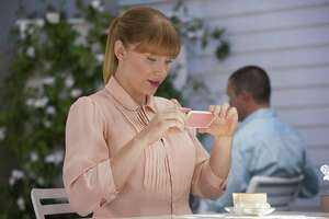 The status-hungry Lacie (Bryce Dallas Howard) keeps checking her smart phone in hopes of a higher approval rating total in the darkly comical 'Nosedive,' and episod of 'Black Mirror,' season three, on Netflix.