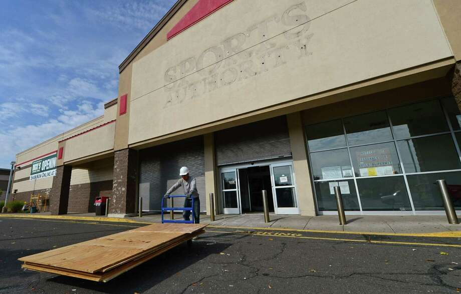 Workers with Montgomery Development begin renovations at the former Sports Authority store on Connecticut Ave. in Norwalk, Conn. Thursday, October 20, 2016, to make way for a Dick's Sporting Goods store which plans to open in 2017. Photo: Erik Trautmann / Hearst Connecticut Media / Norwalk Hour