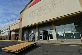 Workers with Montgomery Development begin renovations at the former Sports Authority store on Connecticut Ave. in Norwalk, Conn. Thursday, October 20, 2016, to make way for a Dick's Sporting Goods store which plans to open in 2017.