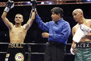 San Antonio's Javier Rodriguez (left) celebrates his unanimous decision win over Alejandro Moreno (right) after their super bantamweight bout as part of the Premier Boxing Champions card on Dec. 12, 2015 at the AT&T Center.