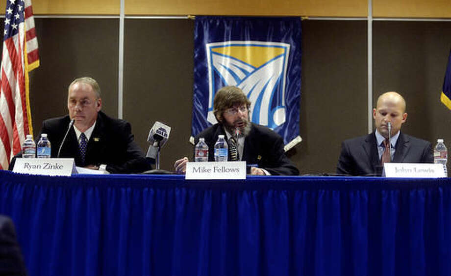 FILE - In this Oct. 21, 2014, file photo, Libertarian Mike Fellows, center, flanked by Republican Ryan Zinke, left, and Democrat John Lewis, answers a question during the U.S. House debate in Heritage Hall on the Great Falls College Montana State University Campus in Great Falls, Mont. Missoula County sheriff's officials said Fellows died in a head-on collision with another vehicle on Montana Highway 200 on Monday, Sept. 19, 2016. (Rion Sanders/The Great Falls Tribune via AP, File)