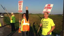Striking Jim Beam workers upset over extended work hours were presented a new contract offer Thursday that includes a company pledge to hire more employees, a union official said.