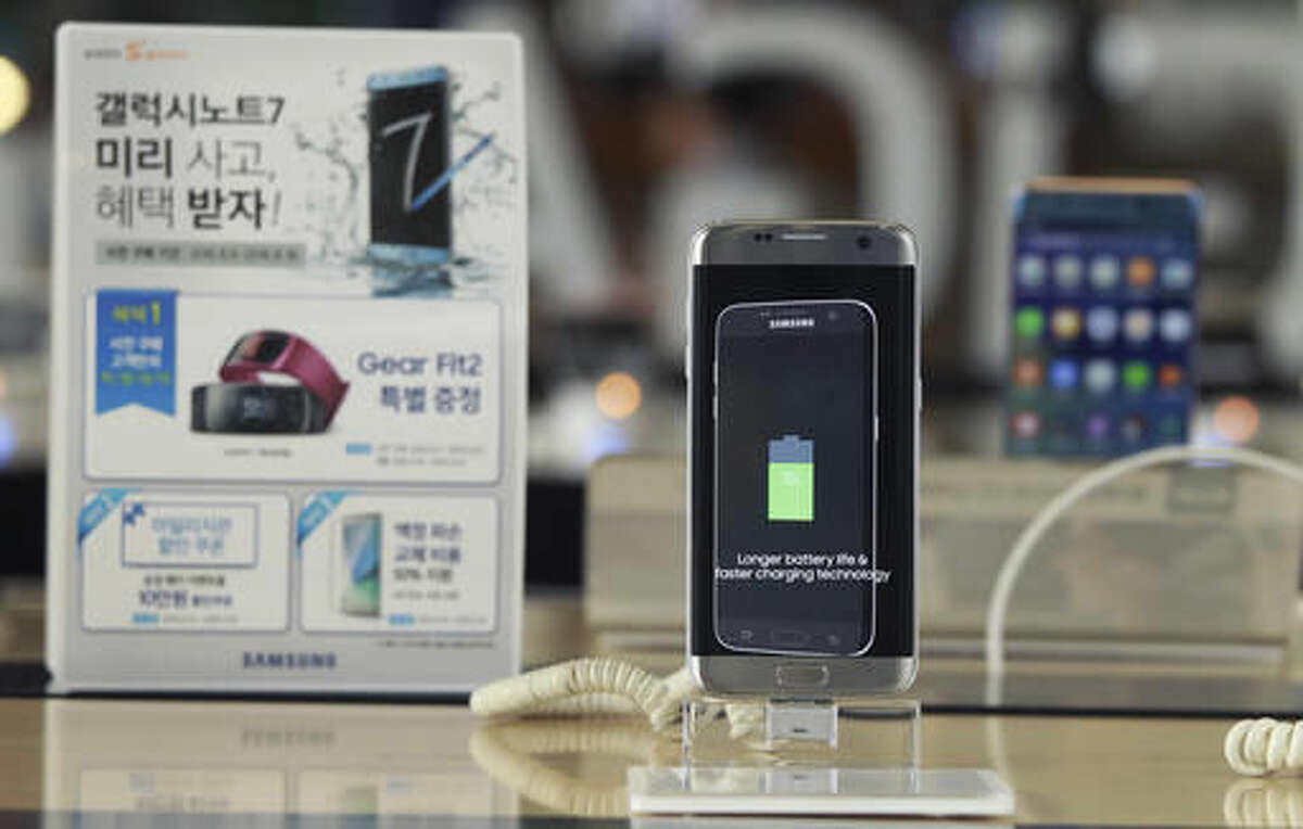 In this Sept. 8, 2016 photo, a Samsung Electronics' Galaxy Note 7 smartphone is displayed at the headquarters of South Korean mobile carrier KT in Seoul, South Korea. Samsung Electronics recommended South Korean customers to stop using the new Galaxy Note 7 smartphones, which the company is recalling worldwide after several dozen of them caught fire. The South Korean technology giant in a statement on its website Saturday, Sept. 10, 2016, advised local users to visit the company's service centers to receive rental phones for temporary use. (AP Photo/Ahn Young-joon)
