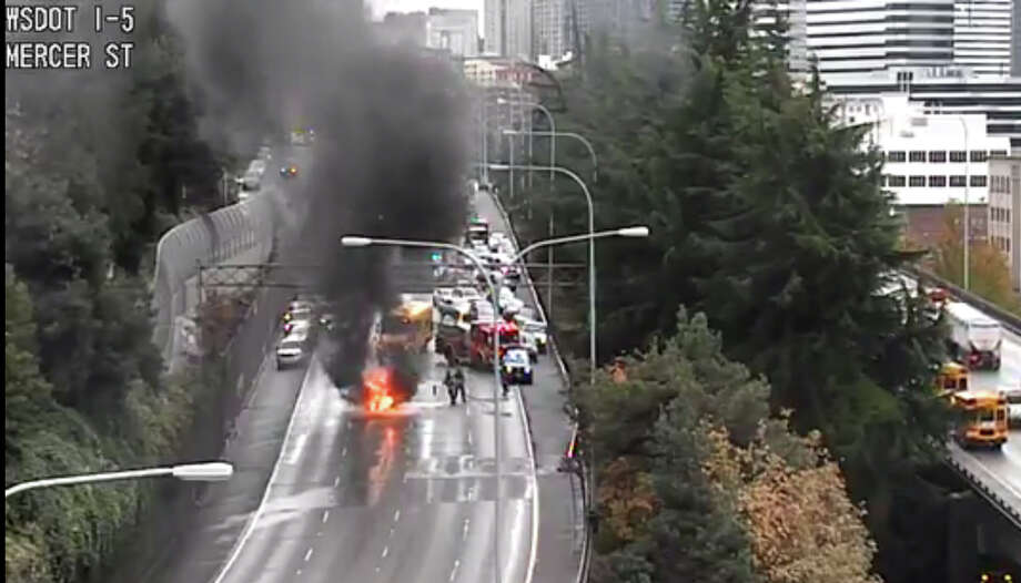 Traffic was blocked on all lanes of northbound Interstate 5 at Seattle after a car burst into flames there in on Thursday afternoon Photo: Washington Department Of Transportation