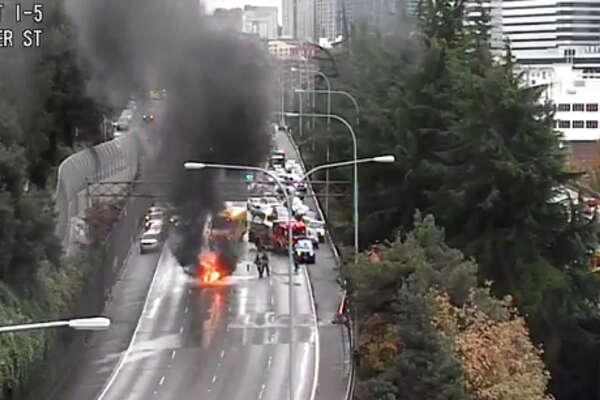 Traffic was blocked on all lanes of northbound Interstate 5 at Seattle after a car burst into flames there in on Thursday afternoon