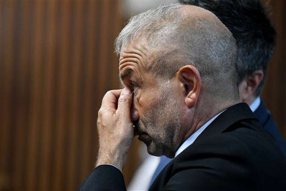 Alain Kaloyeros, president of SUNY Polytechnic Institute awaits his arraignment on state charges while sitting in a courtroom at Albany City Courthouse on Friday, Sept. 23, 2016, in Albany, N.Y. The attorney general's office says Kaloyeros is accused of restraint of trade along with 59-year-old Joseph Nicolla, president of Columbia Development. The state complaint alleges Kaloyeros agreed to steer construction contract awards to hand-picked companies, including Columbia for student housing. (Will Waldron/The Albany Times Union via AP)