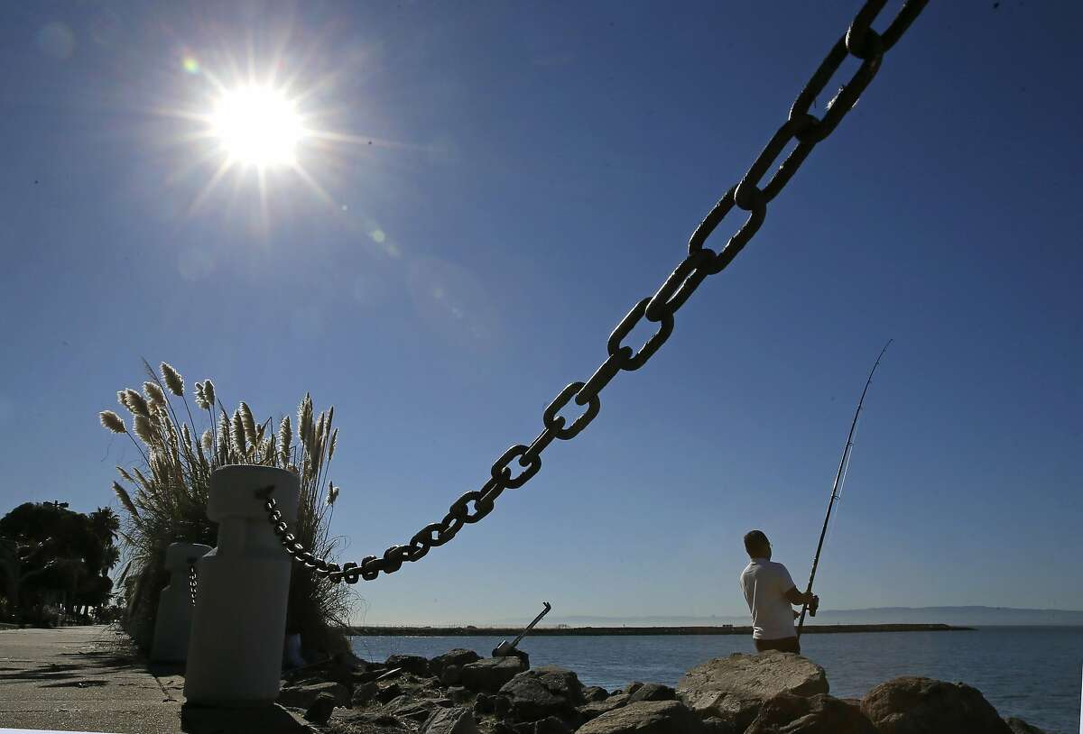 Tu Trane of Alameda, tries his luck at fishing at the western edge of Bay Farm Island in Alameda, California, on Thursday October 20, 2016.