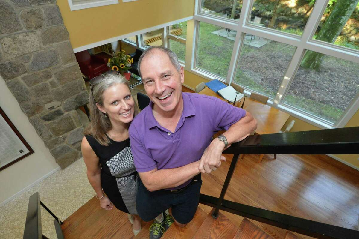 Collene and Mark Torres inside their home in Silvermine, a mid-century modern house on the Silvermine river on Tuesday September 27, 2016 in Norwalk Conn