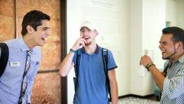 San Antonio, Texas -- October 6, 2016 -- Christian Harmon, left, talks with Noah Hildebrand, center, and Efrain Aguero, right, at Texas A&M San Antonio. Ray Whitehouse / for the San Antonio Express-News