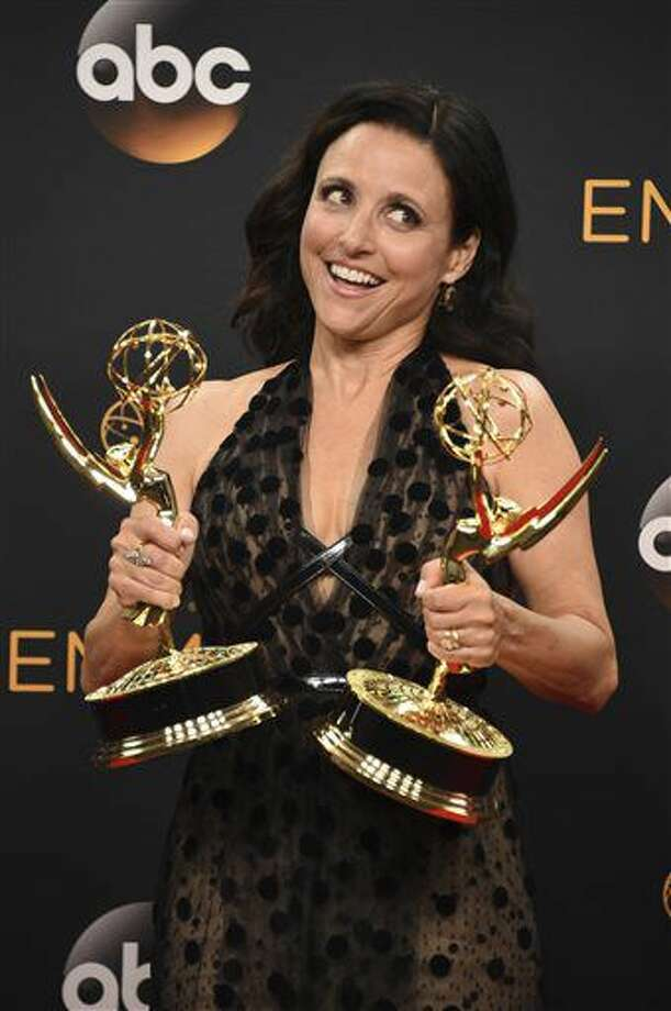 "Julia Louis-Dreyfus winner of the award for outstanding lead actress in a comedy series and best comedy series for ""Veep"" poses in the press room at the 68th Primetime Emmy Awards on Sunday, Sept. 18, 2016, at the Microsoft Theater in Los Angeles. (Photo by Jordan Strauss/Invision/AP)"