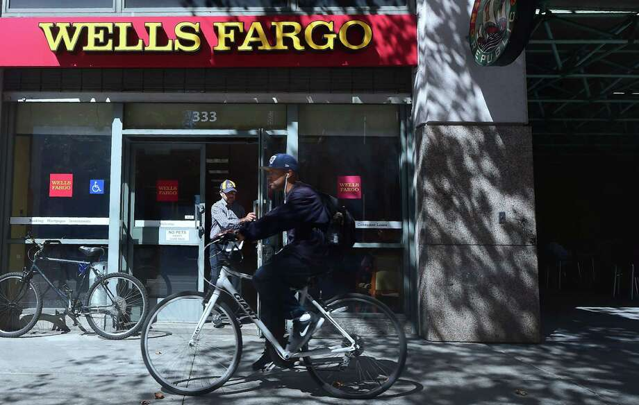Wells Fargo, under fire for creating 2 million unauthorized accounts for its customers, is under a criminal investigation in California over alleged identity theft. Photo: Frederic J Brown /AFP /Getty Images / AFP or licensors