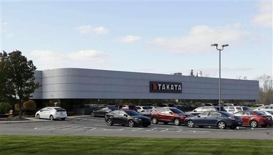 In this Oct. 22, 2014 file photo, the Takata building, an automotive parts supplier in Auburn Hills, Mich. is seen on Wednesday, Oct. 22, 2014. The company is the North American subsidiary of the Japanese based Takata Corporation, which supplies seat belts and airbags for the automotive industry. The National Highway Traffic Safety Administration announced today that more than 2 million Toyota, Chrysler and Honda vehicles are being recalled for faulty air bags that may inflate while the car is running. The agency says about 1 million Toyota and Honda vehicles involved in the new recalls are also subject to a separate recall related to defective Takata air bags that could deploy and rupture with enough force to cause injury or death.