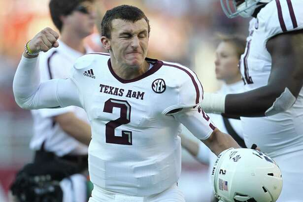 Texas A&M quarterback Johnny Manziel (2) as the touchdown was called after review during the first quarter of a college football game at Bryant-Denny Stadium, Saturday, Nov. 10, 2012, in Tuscaloosa.  ( Karen Warren / Houston Chronicle )
