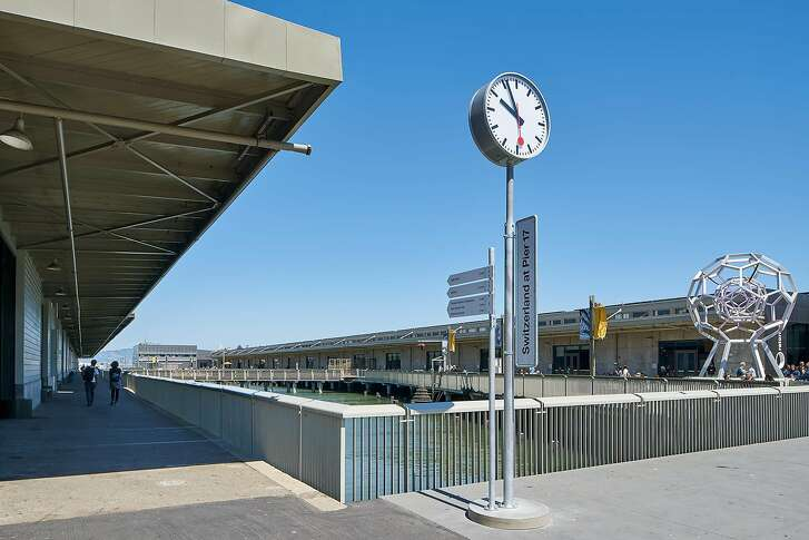 A Swiss clock monument, designed by Oliver Chetelat, marks the entrance to the new Swissnex Gallery on Pier 17.