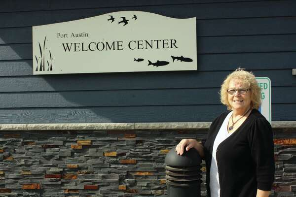 Joyce Stanek poses in front of the Port Austin Welcome Center.