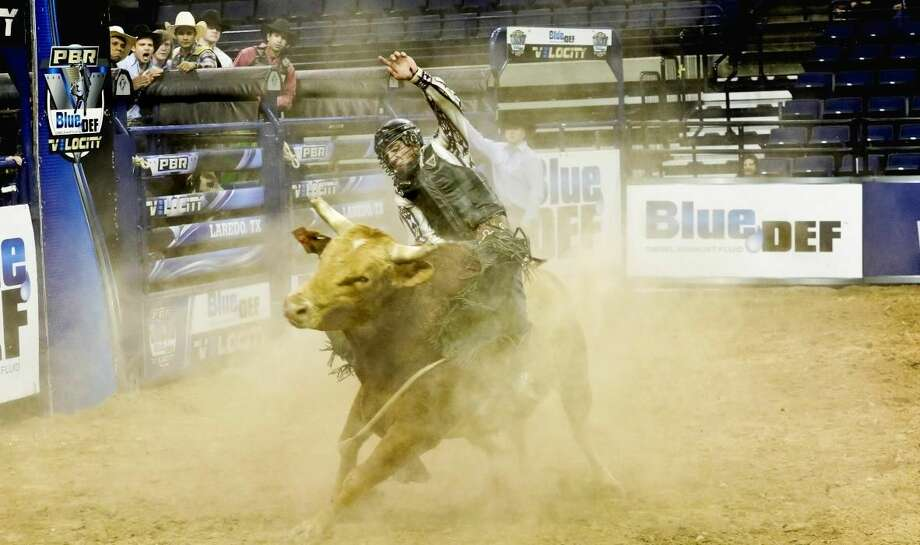 Professional bull rider Chon Miranda competes Sunday afternoon during the PBR Blue DEF Velocity Tour at Laredo Energy Arena. See related photos on LMT's Facebook page, and in Monday's paper and e-Edition. Photo by Victor Strife