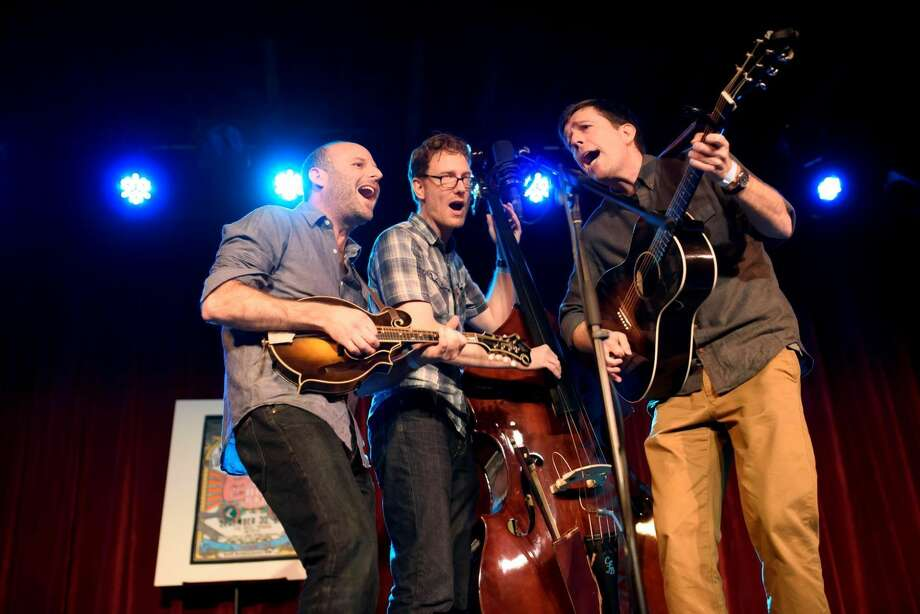 "The Lonesome Dove Trio, from left, Jacob Tilove, Ian Riggs and Ed Helms, perform during ""Michael Daves's All-Star Bluegrass Throw-Down"" in New York, on Friday. The group writes old-timey songs with a droll contemporary perspective. Photo by Karsten Moran/The New York Times"