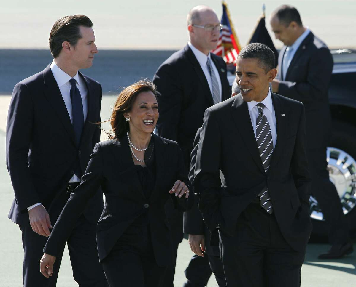 President Barack Obama walks with Attorney General Kamala Harris, Lt. Gov. Gavin Newsom and Mayor Ed Lee (not seen) after his arrival aboard Air Force One at SFO in San Francisco, Calif. on Thursday, Feb. 16, 2012 to attend private fundraising events this evening.